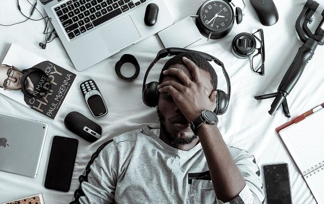 Man lying on back listening to music