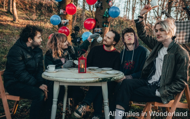 All Smiles in Wonderland having a party with balloons in the woods