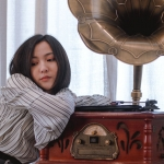 Woman listening to gramophone