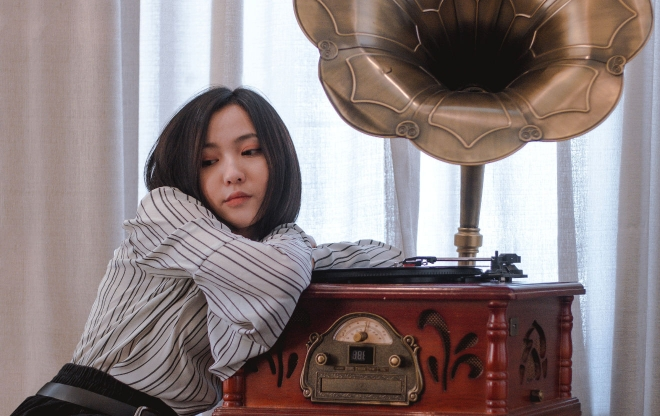 Woman listening to gramophone