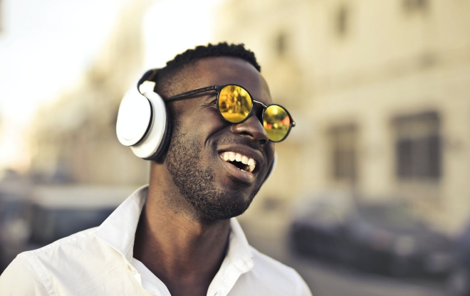 Photo of a man in sunglasses and headphones
