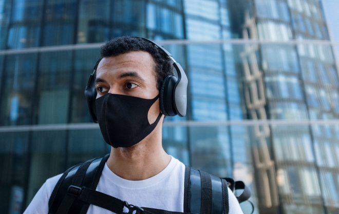 Man with headphones and face mask