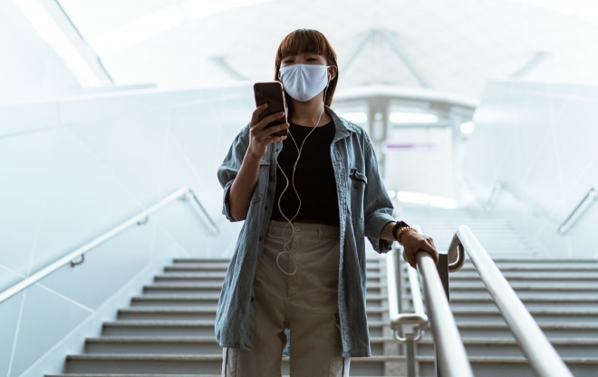 Woman in mask with headphones