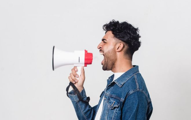 Man shouting into a megaphone