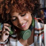 Woman, smiling, with headphones